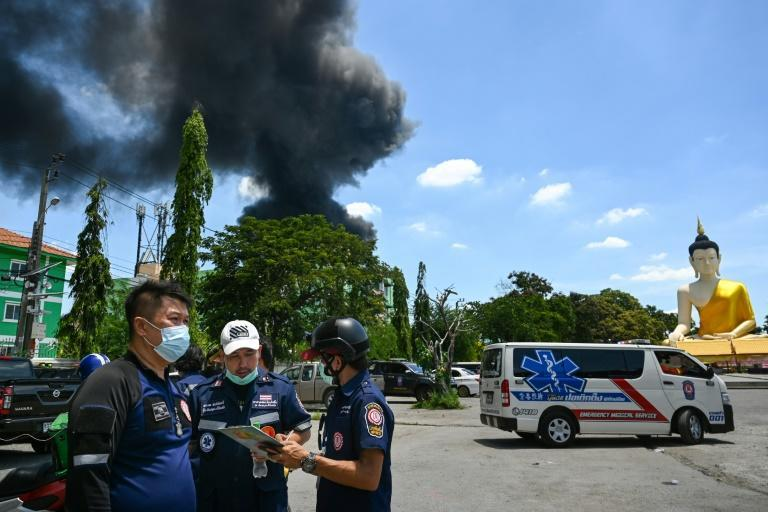 Throughout the day, the changing direction of the wind shifted jet-black fumes across Bangkok