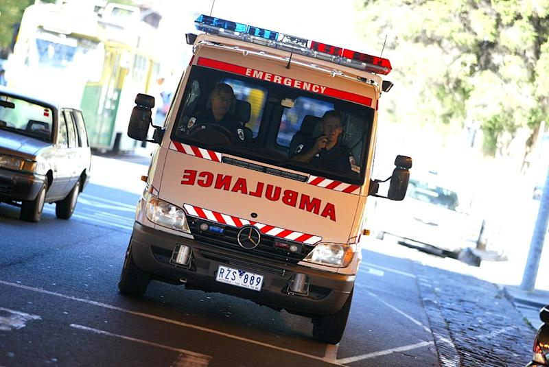 An ambulance leaves a Melbourne hospital, 24 May 2003.