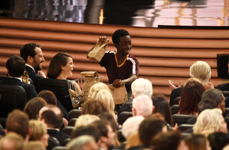 Caleb McLaughlin distributes sandwiches at the 68th Primetime Emmy Awards on Sunday, Sept. 18, 2016, at the Microsoft Theater in Los Angeles. (Photo by Chris Pizzello/Invision/AP)