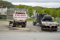 A tractor trailer rig pulls into a terminal for a trucking company that has a $10,000 hiring bonus offer posted on a trailer at their facility in Harmony, Pa., Wednesday, May 5, 2021. A bill by Pennsylvania's Republican-controlled Legislature to reinstate work-search requirements for people claiming unemployment benefits cleared the House Labor and Industry Committee on a party-line vote Tuesday. The sponsor, Rep. Jim Cox of Berks County, said many employers are having trouble finding workers. (AP Photo/Keith Srakocic)