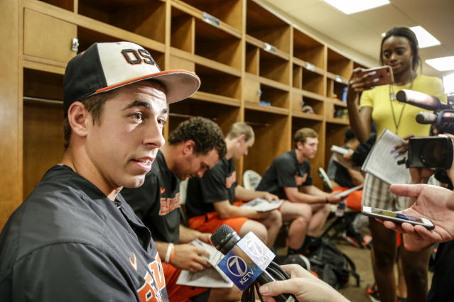 Oregon State pitcher Luke Heimlich answers questions in the clubhouse following practice at TD Ameritrade Park in Omaha Friday.  (AP Photo)