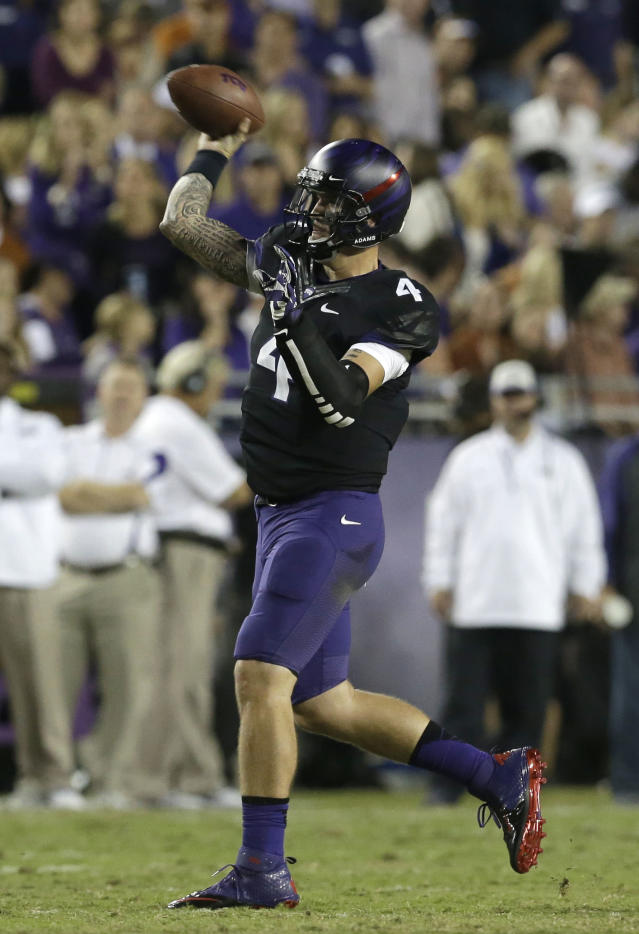 TCU quarterback Casey Pachall (4) passes during the first half of an NCAA college football game against Texas, Saturday, Oct. 26, 2013, in Fort Worth, Texas. (AP Photo/LM Otero)