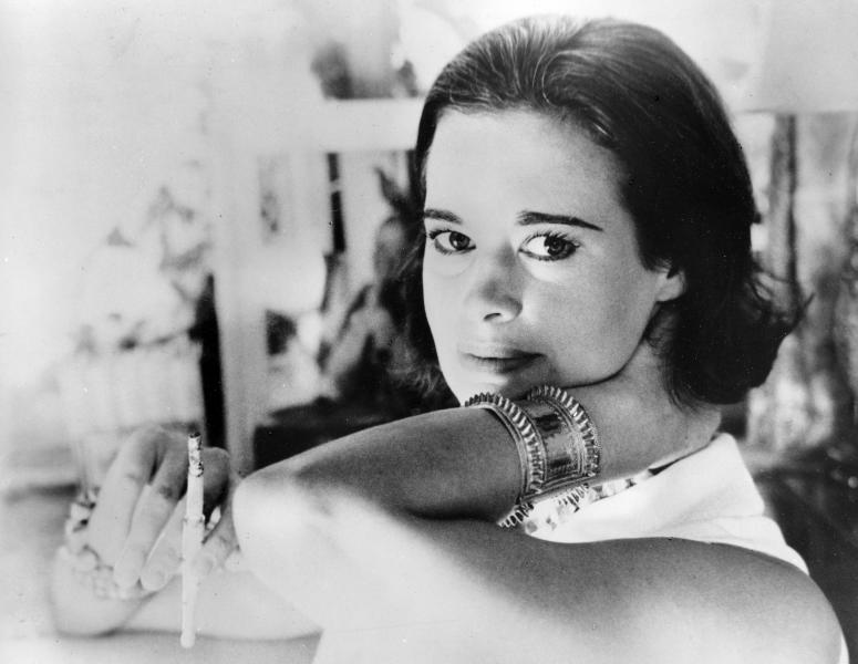 """FILE - In this Jan. 4, 1964 file photo, railroad heiress Gloria Vanderbilt poses for a photograph. Vanderbilt, the intrepid heiress, artist and romantic who began her extraordinary life as the """"poor little rich girl"""" of the Great Depression, survived family tragedy and multiple marriages and reigned during the 1970s and '80s as a designer jeans pioneer, died Monday, June 17, 2019,  at the age of 95.  (AP Photo, File)"""