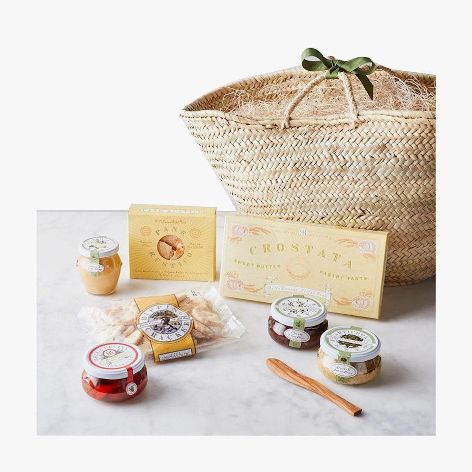 """Food52's pasta-lover's hamper is a mambo Italiano in a basket. $239, Food52. <a href=""""https://food52.com/shop/products/6508-italian-antipasti-basket-gift-set"""" rel=""""nofollow noopener"""" target=""""_blank"""" data-ylk=""""slk:Get it now!"""" class=""""link rapid-noclick-resp"""">Get it now!</a>"""