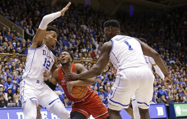 Duke's Javin DeLaurier (12) and Zion Williamson (1) defend against St. John's Shamorie Ponds during the first half of an NCAA college basketball game in Durham, N.C., Saturday, Feb. 2, 2019. (AP Photo/Gerry Broome)