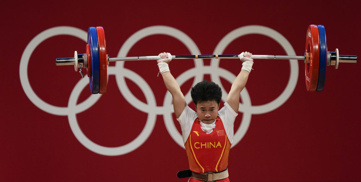 TOKYO, JAPAN - JULY 24: Zhihui Hou of Team China competes during the Weightlifting - Women's 49kg Group A on day one of the Tokyo 2020 Olympic Games at Tokyo International Forum on July 24, 2021 in Tokyo, Japan. (Photo by Fred Lee/Getty Images)