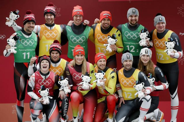 Luge - Pyeongchang 2018 Winter Olympic Games - Team Relay - Pyeongchang, South Korea - February 15, 2018 - Gold medalists Natalie Geisenberger, Johannes Ludwig, Tobias Wendl and Tobias Arlt of Germany, silver medalists Alex Gough, Sam Edney, Tristan Walker and Justin Snith of Canada, bronze medalists Madeleine Egle, David Gleirscher, Peter Penz and Georg Fischler of Austria during the victory ceremony. REUTERS/Arnd Wiegmann