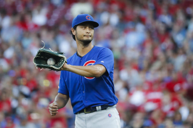 Chicago Cubs starting pitcher Yu Darvish reacts after giving up a two-run home run to Cincinnati Reds' Aristides Aquino in the second inning of a baseball game, Friday, Aug. 9, 2019, in Cincinnati. (AP Photo/John Minchillo)
