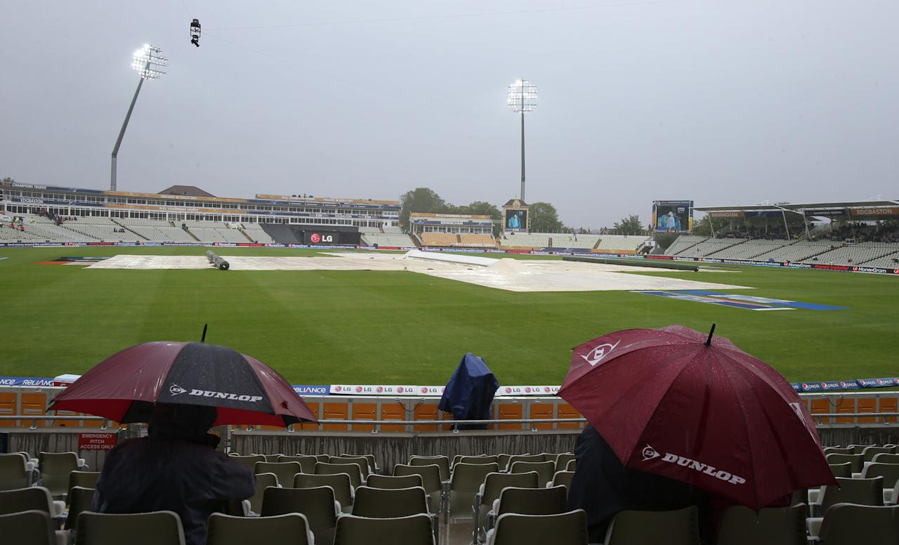 Covers on the pitch as rain delays play during the ICC Champions Trophy match between Australia and New Zealand at Edgbaston, Birmingham.