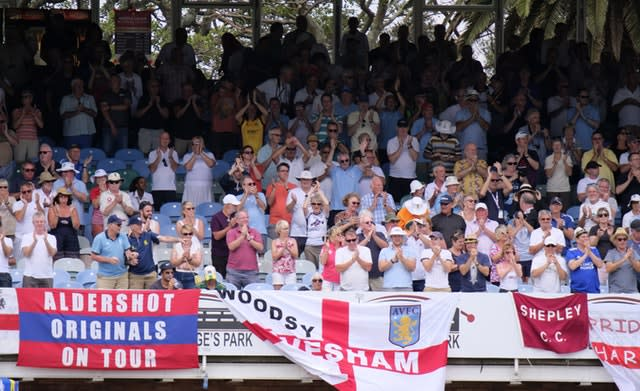 England fans perform a standing ovation for Pope as he makes his hundred