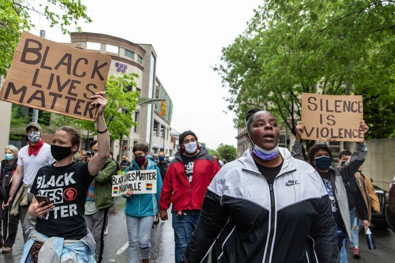 Supporters of Black Lives Matter march toward City Hall during to protest recent incidents around the country of police shootings in Nashville, Tennessee on April 24, 2021.