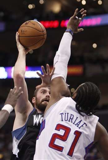 Los Angeles Clippers' Ronny Turiaf attempts to block a shot by Minnesota Timberwolves' Kevin Love during the first half of an NBA basketball game in Los Angeles, Wednesday, Nov. 28, 2012. (AP Photo/Christine Cotter)
