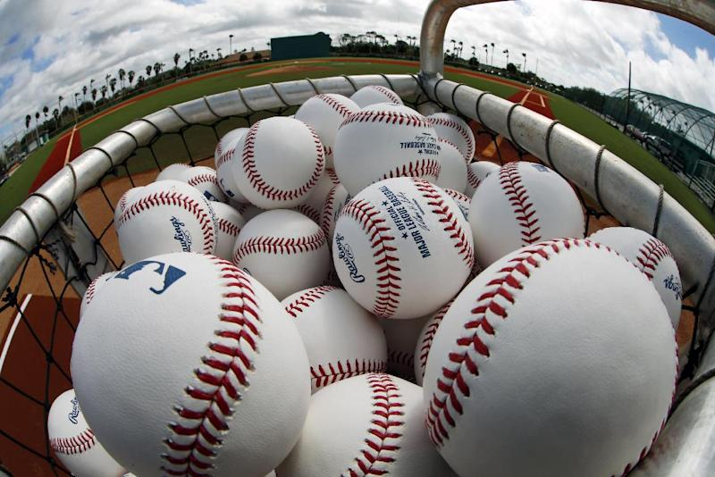 A basket of baseballs sits on the Honus Wagner practice field at the Pittsburgh Pirates practice facility on the team's first day of baseball spring training for pitchers and catchers in Bradenton, Fla., Thursday, Feb. 13, 2014. (AP Photo/Gene J. Puskar)