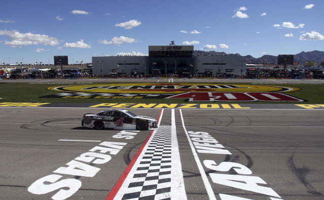 "<a class=""link rapid-noclick-resp"" href=""/nascar/sprint/drivers/205/"" data-ylk=""slk:Kevin Harvick"">Kevin Harvick</a> passes the start/finish line during a NASCAR Cup series auto race Sunday, March 4, 2018, in Las Vegas. (AP Photo/Isaac Brekken)"