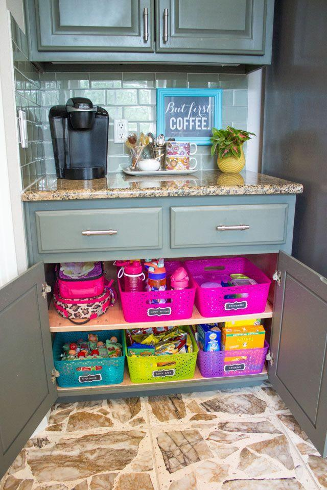 """<p>Use this school lunch organizing system, which keeps all your snacks, bags, boxes, and bottles labeled and in one place. </p><p><strong><em><a href=""""https://designimprovised.com/2016/08/how-to-create-school-lunch-station.html"""" rel=""""nofollow noopener"""" target=""""_blank"""" data-ylk=""""slk:Get the tutorial at Design Improved"""" class=""""link rapid-noclick-resp"""">Get the tutorial at Design Improved</a>. </em></strong></p><p><a class=""""link rapid-noclick-resp"""" href=""""https://www.amazon.com/Containers-3-Compartment-Container-Microwave-Dishwasher/dp/B01HUKL0C4?tag=syn-yahoo-20&ascsubtag=%5Bartid%7C10070.g.37133630%5Bsrc%7Cyahoo-us"""" rel=""""nofollow noopener"""" target=""""_blank"""" data-ylk=""""slk:SHOP BENTO LUNCH BOXES"""">SHOP BENTO LUNCH BOXES</a></p>"""