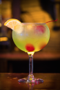 """<p>This drink tastes like a liquid Jolly Rancher—but don't forget it's about half-full of alcohol. </p><p>Get the recipe from <a href=""""https://www.delish.com/cooking/recipe-ideas/recipes/a43895/halloween-cocktail-ideas-good-and-evil-cocktail-recipe/"""" rel=""""nofollow noopener"""" target=""""_blank"""" data-ylk=""""slk:Delish"""" class=""""link rapid-noclick-resp"""">Delish</a>. </p>"""