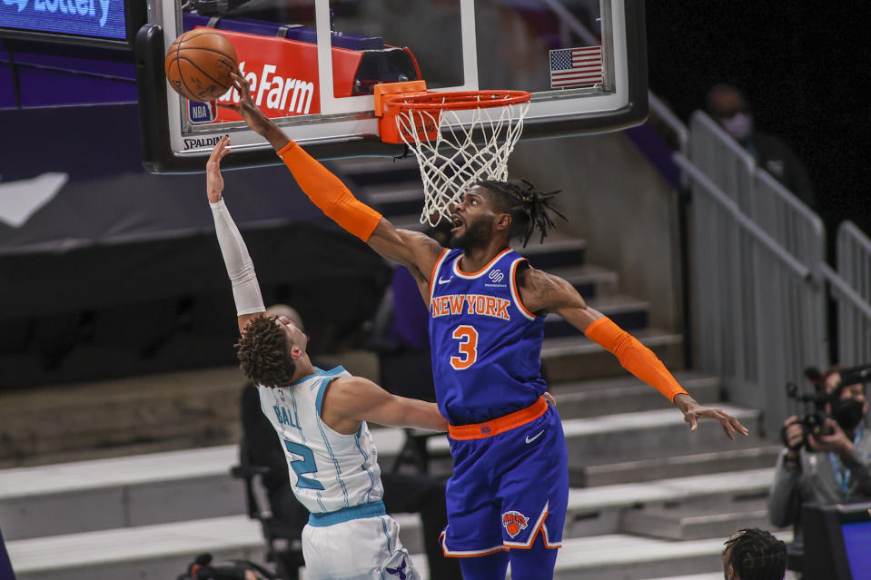New York Knicks center Nerlens Noel (3) blocks a shot by Charlotte Hornets guard LaMelo Ball (2) in the first quarter of an NBA basketball game in Charlotte, N.C., Monday, Jan. 11, 2021. (AP Photo/Nell Redmond)