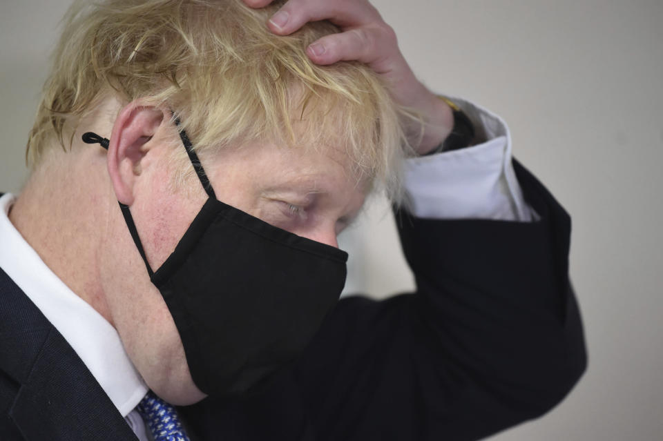 Britain's Prime Minister Boris Johnson gestures, during a visit to Tollgate Medical Centre in Beckton, East London, Friday July 24, 2020. (Jeremy Selwyn/Pool Photo via AP)