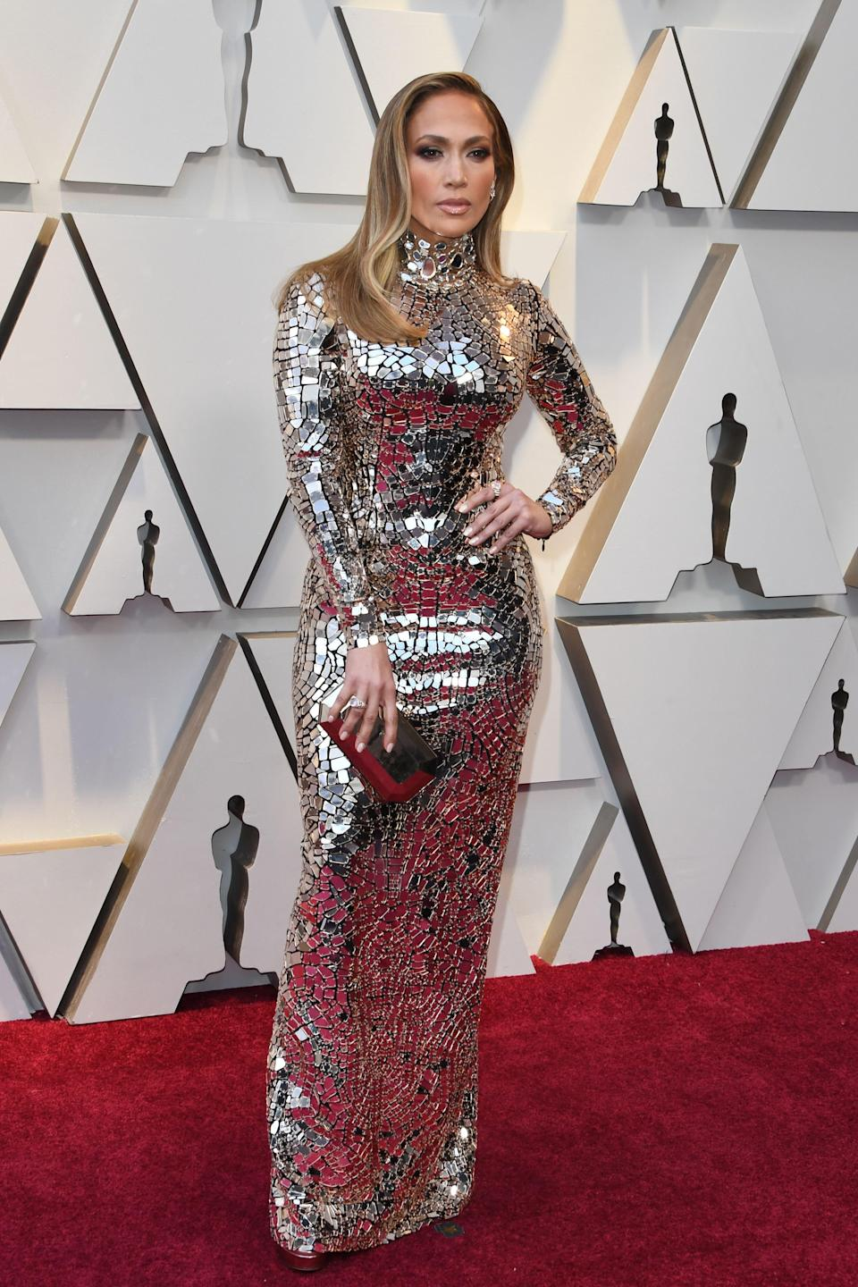 <p>J. Lo always brings the glamour – and tonight is no exception! The superstar shimmered on the red carpet in a silver gown by Tom Ford. (Image via Getty Images) </p>