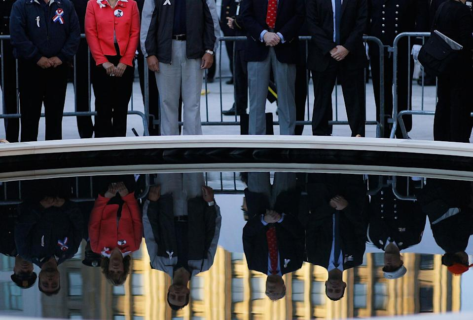 <p>People stand around a reflecting pool in the middle of Ground Zero before the annual memorial service September 11, 2010 in New York City. Thousands will gather to pay a solemn homage on the ninth anniversary of the terrorist attacks that killed nearly 3,000 people on September 11, 2001. (Photo by Chris Hondros/Getty Images) </p>