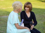 Actresses Ruta Lee, left, and Stefanie Powers mingle before a ceremony to unveil a memorial sculpture of the late actor Burt Reynolds at Hollywood Forever Cemetery, Monday, Sept. 20, 2021, in Los Angeles. Reynolds died in 2018 at the age of 82. (AP Photo/Chris Pizzello)
