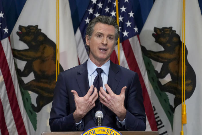 FILE - In this Jan. 8, 2021, file photo, California Gov. Gavin Newsom gestures during a news conference in Sacramento, Calif. Sacramento County Superior Court Judge James Arguelles ruled Monday July 12, 2021, that Newsom cannot belatedly put his Democratic Party affiliation next to his name on the ballot California voters will see when they decide if he should be removed from office in the Sept.14 recall election. (AP Photo/Rich Pedroncelli, Pool, File)