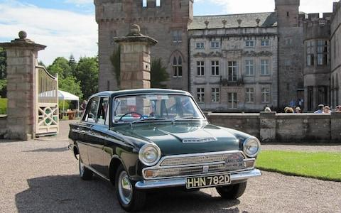 A Ford Cortina Mk1 in front of the splendid house at Hutton-in-the-Forest