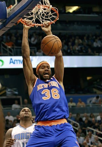 New York Knicks' Rasheed Wallace (36) dunks the ball in front of Orlando Magic's Glen Davis, left, during the first half of an NBA basketball game, Tuesday, Nov. 13, 2012, in Orlando, Fla. (AP Photo/John Raoux)