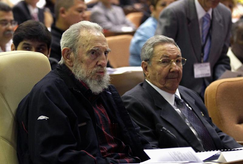 Cuba's President Raul Castro, right, and brother Fidel Castro attend the opening session of the National Assemby in Havana, Cuba, Sunday, Feb. 24, 2012. Cuba's parliament reconvened Sunday with new membership and was expected to name Raul Castro to a new five-year-term as president. Raul Castro fueled speculation on Friday when he talked of his possible retirement and suggested he has plans to resign at some point.(AP Photo/Ismael Francisco, Cubadebate)