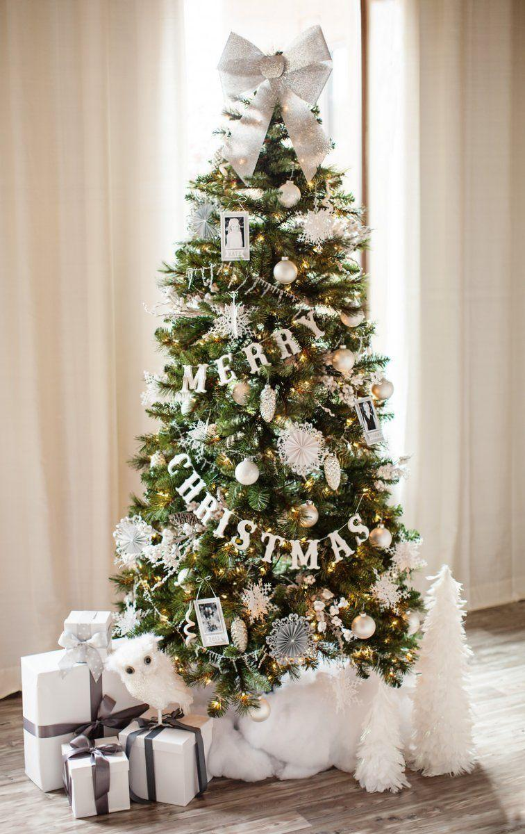"<p>Hang a banner on your tree to spread the love. It's the perfect alternative to displaying a set of words on a mantle or elsewhere that'll take up space. You can then use that freed up space for other decor!</p><p>See more at <a href=""http://www.thetomkatstudio.com/diychristmastreegarland/"" rel=""nofollow noopener"" target=""_blank"" data-ylk=""slk:The Tomkat Studio"" class=""link rapid-noclick-resp"">The Tomkat Studio</a>.</p><p><a class=""link rapid-noclick-resp"" href=""https://www.amazon.com/Christmas-Banner-Glitter-Decoration-Supplies/dp/B07F2WZBV7/?tag=syn-yahoo-20&ascsubtag=%5Bartid%7C10057.g.505%5Bsrc%7Cyahoo-us"" rel=""nofollow noopener"" target=""_blank"" data-ylk=""slk:SHOP BANNERS"">SHOP BANNERS</a> <em><strong>Merry Christmas Banner, $8</strong></em><br></p>"