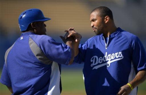 Los Angeles Dodgers' Juan Uribe, left, jokes around with Matt Kemp during batting practice for a baseball game against the San Francisco Giants, Tuesday, June 25, 2013, in Los Angeles. (AP Photo/Mark J. Terrill)