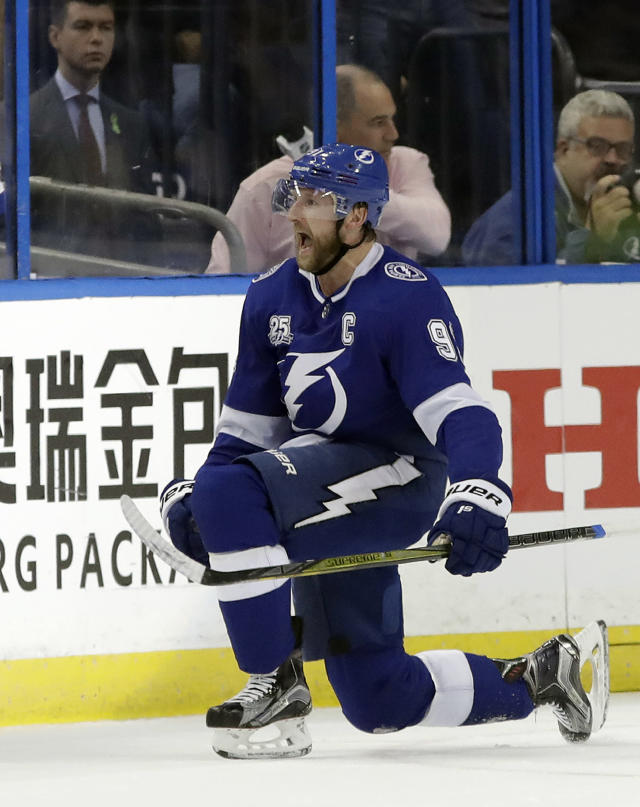 Tampa Bay Lightning center Steven Stamkos (91) celebrates after his goal against the Washington Capitals during the first period of Game 2 of the NHL Eastern Conference finals hockey playoff series Sunday, May 13, 2018, in Tampa, Fla. (AP Photo/Chris O'Meara)