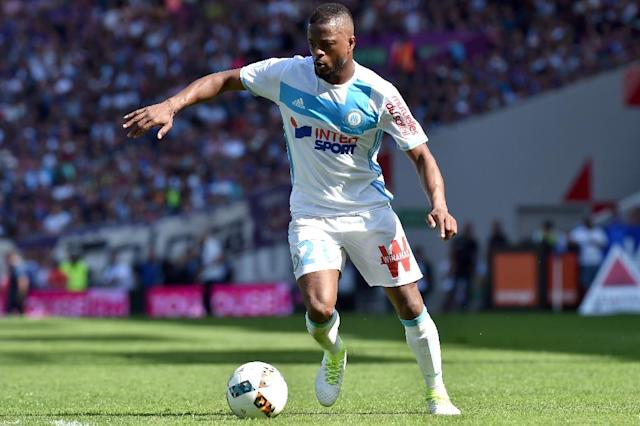 After being hit with a season-long ban and losing his job at Marseille for a karate kick on a supporter, Patrice Evra (seen here) was backed by former team-mate Steve Mandanda (AFP Photo/REMY GABALDA)