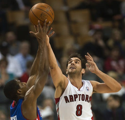 Toronto Raptors guard Jose Calderon, right, and Detroit Pistons guard Brandon Knight battle for the loose ball during first-half NBA basketball game action in Toronto, Wednesday, Feb. 22, 2012. (AP Photo/The Canadian Press, Nathan Denette)