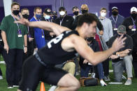 Scouts from all 32 NFL teams attend Northwestern's Pro Day football workout Tuesday, March 9, 2021, in Evanston, Ill. (AP Photo/Charles Rex Arbogast)