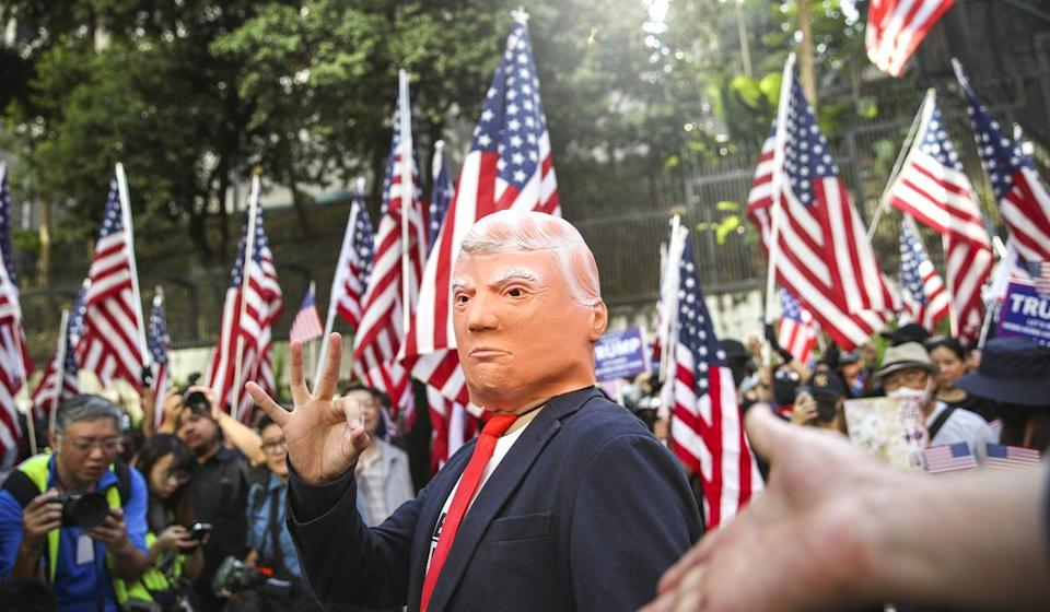 A Donald Trump impersonator gestures during a rally at Chater Garden in December after President Trump signed the Hong Kong Human Rights and Democracy Act into effect. Photo: Winson Wong