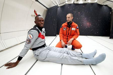 Retired sprinter Usain Bolt poses inside a specially modified Airbus Zero-G plane before a zero gravity conditions flight above Reims, France, September 12, 2018. REUTERS/Benoit Tessier