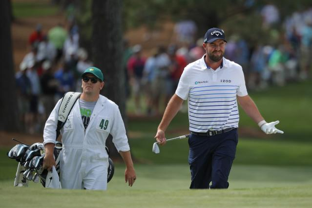 Marc Leishman of Australia reacts to his chip shot as he walks up to the 7th green with his caddie Matthew Kelly during second round play of the 2018 Masters golf tournament at the Augusta National Golf Club in Augusta, Georgia, U.S., April 6, 2018. REUTERS/Brian Snyder