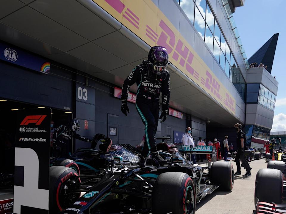 Mercedes' Lewis Hamilton leaves his car after taking pole position at Silverstone: POOL/AFP via Getty Images