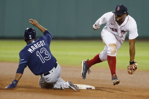 Boston Red Sox's Xander Bogaerts makes the force out at second base on Tampa Bay Rays' Manuel Margot (13) during the fourth inning of a baseball game, Monday, Aug. 10, 2020, in Boston. (AP Photo/Michael Dwyer)