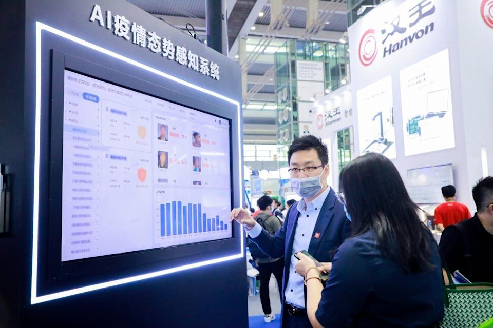 China Hi-Tech Fair exhibitor Intellifusion presents its artificial intelligence-powered pandemic control and prevention applications at the event in Shenzhen. Photo: Handout