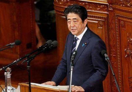 Japanese Prime Minister Shinzo Abe gives an address at the start of the new parliament session at the lower house of parliament in Tokyo