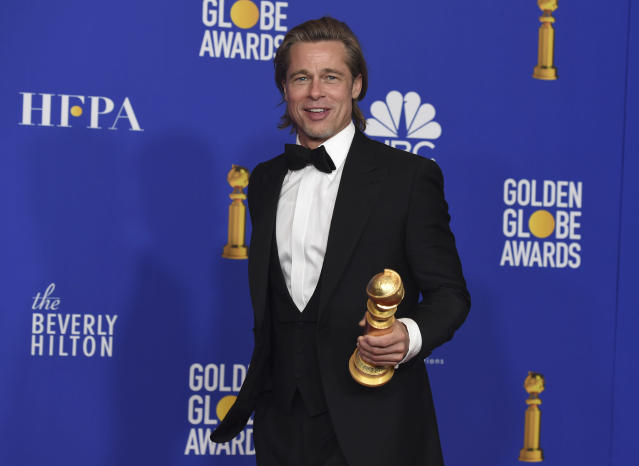 """Brad Pitt poses in the press room with the award for best performance by an actor in a supporting role in any motion picture for """"Once Upon a Time...in Hollywood"""" at the 77th annual Golden Globe Awards. (AP Photo/Chris Pizzello)"""