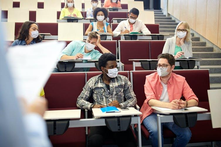 Students wearing masks in lecture theatre