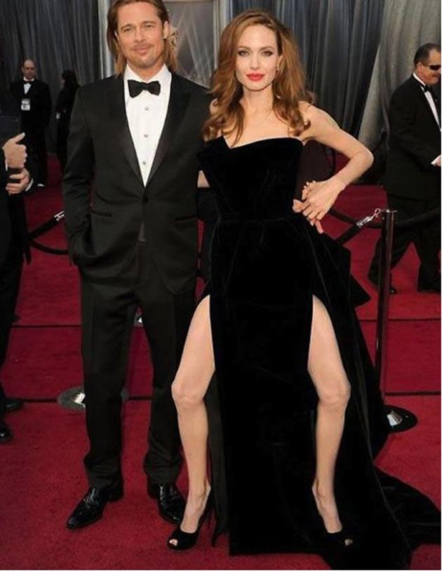 """<b>Oscars 2012: Angelina's right leg goes viral</b><br><br><b>[Related gallery: </b><a href=""""http://uk.movies.yahoo.com/photos/oscars-2012-red-carpet-photos-1330099441-slideshow/"""" data-ylk=""""slk:Oscars 2012: All the red carpet photos;outcm:mb_qualified_link;_E:mb_qualified_link;ct:story;"""" class=""""link rapid-noclick-resp yahoo-link""""><b>Oscars 2012: All the red carpet photos</b></a><b>]</b>"""