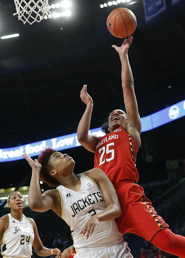 Maryland forward Alyssa Thomas (25) goes up for a shot against Georgia Tech's Aaliyah Whiteside (2) in the first half of an NCAA women's college basketball game, Sunday, Feb. 23, 2014, in Atlanta. (AP Photo/John Bazemore)