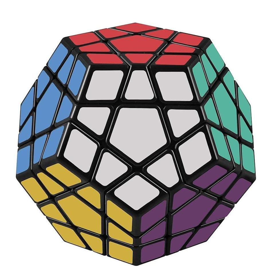 """<p>Test memory and speed with this entertaining <a href=""""https://www.popsugar.com/buy/D-FantiX-Megaminx-Speed-Cube-Puzzle-375109?p_name=%20D-FantiX%20Megaminx%20Speed%20Cube%20Puzzle&retailer=amazon.com&pid=375109&price=11&evar1=moms%3Aus&evar9=32519221&evar98=https%3A%2F%2Fwww.popsugar.com%2Ffamily%2Fphoto-gallery%2F32519221%2Fimage%2F44850300%2FD-FantiX-Megaminx-Speed-Cube-Puzzle&list1=gifts%2Choliday%2Cgift%20guide%2Cgifts%20for%20kids%2Ckid%20shopping%2Ctweens%20and%20teens%2Cgifts%20for%20teens&prop13=api&pdata=1"""" class=""""link rapid-noclick-resp"""" rel=""""nofollow noopener"""" target=""""_blank"""" data-ylk=""""slk:D-FantiX Megaminx Speed Cube Puzzle""""> D-FantiX Megaminx Speed Cube Puzzle</a> ($11). </p>"""