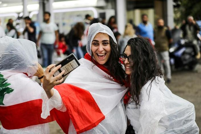 Protesters in Lebanon are using WhatsApp to organise demonstrations that began over a proposed tax on the popular app (AFP Photo/JOSEPH EID)