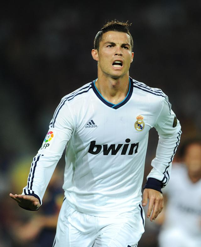 BARCELONA, SPAIN - OCTOBER 07: Cristiano Ronaldo of Real Madrid celebrates scoring his sides opening goal during the la Liga match between FC Barcelona and Real Madrid at the Camp Nou stadium on October 7, 2012 in Barcelona, Spain. (Photo by Jasper Juinen/Getty Images)
