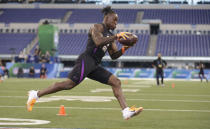 Washington running back Lavon Coleman runs a drill at the NFL football scouting combine in Indianapolis, Friday, March 2, 2018. (AP Photo/Michael Conroy)